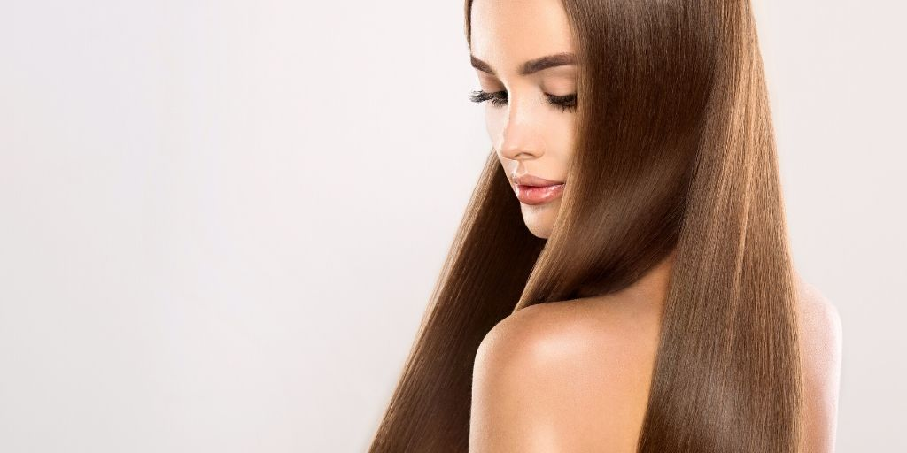 how to make hair grow faster naturally - girl with shiny long hair