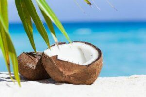 raw coconut on a beach